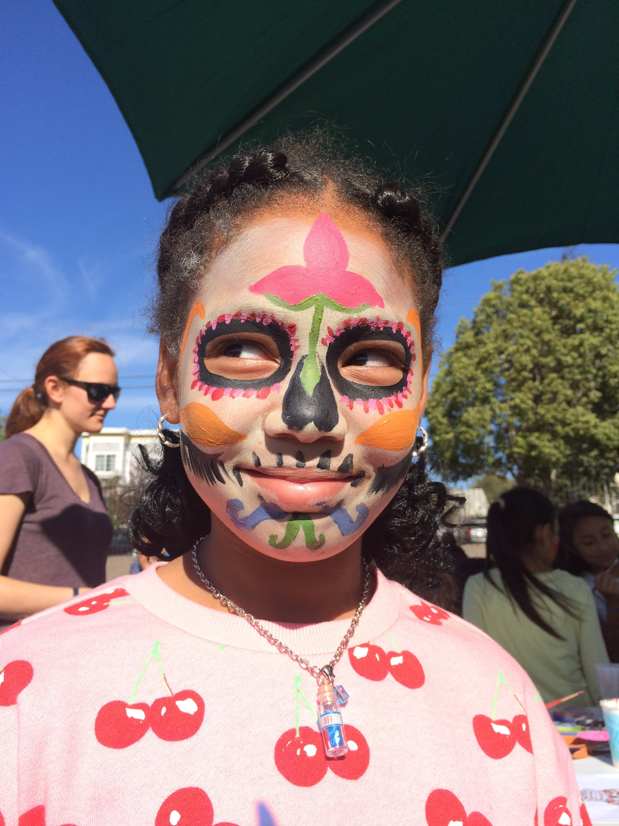 One of our students overjoyed with her beautiful face painting design at the Harvest Festival.
