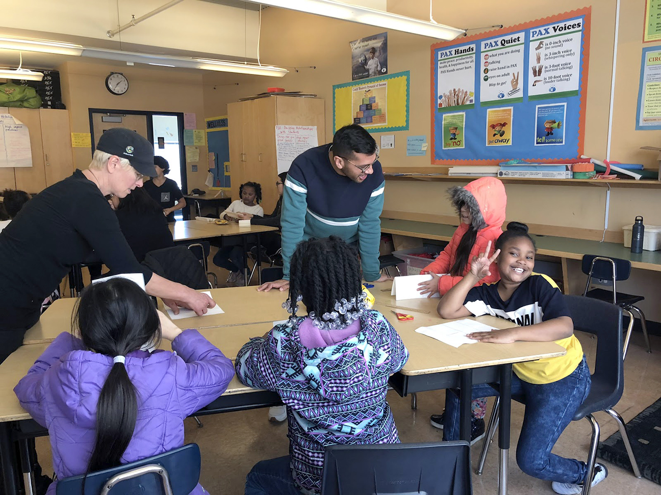 Mr. Eddie and Ms. Nan assisting students in the bookmaking process.
