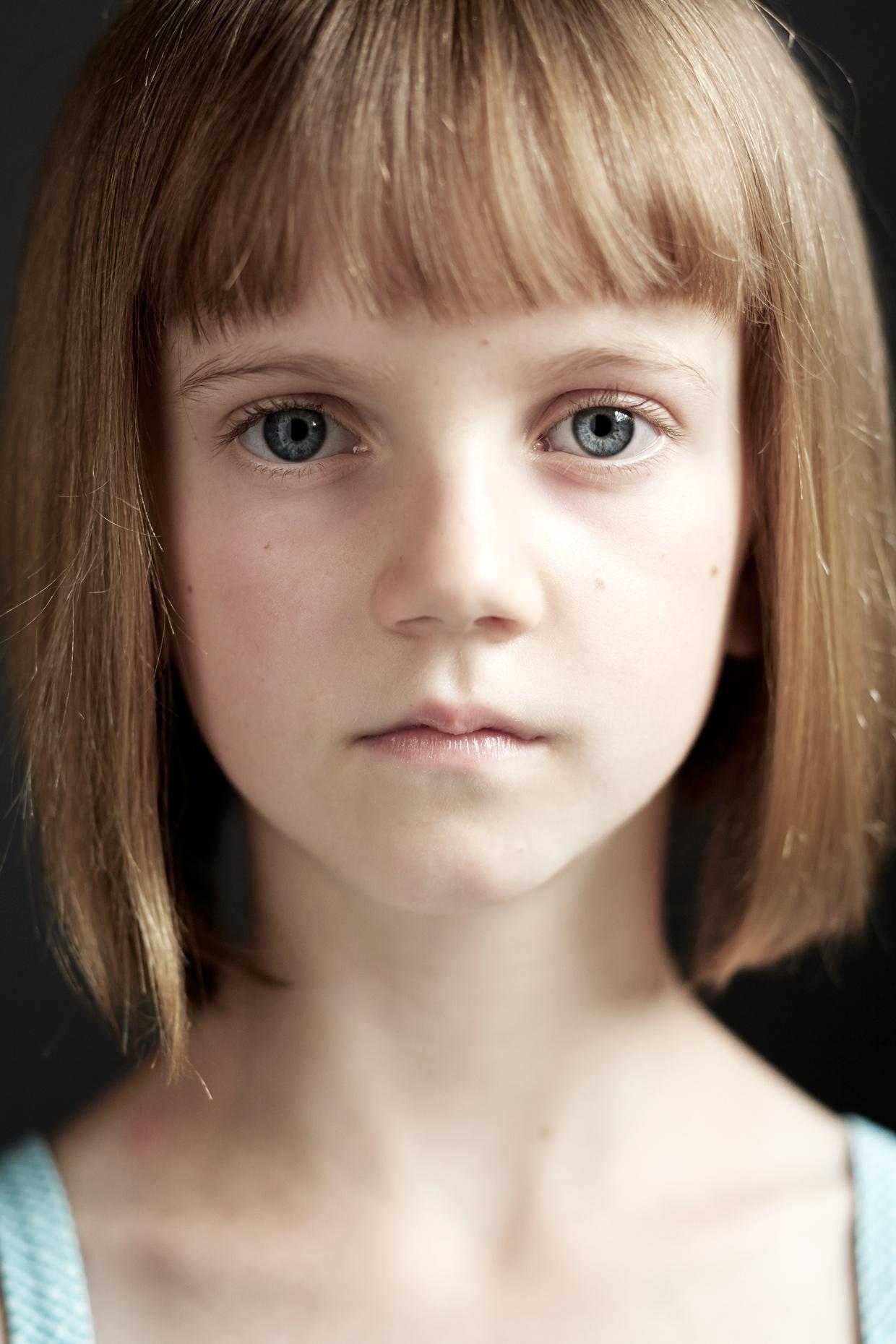 Portrait Photography Derek Israelsen Kid Closeup Serious