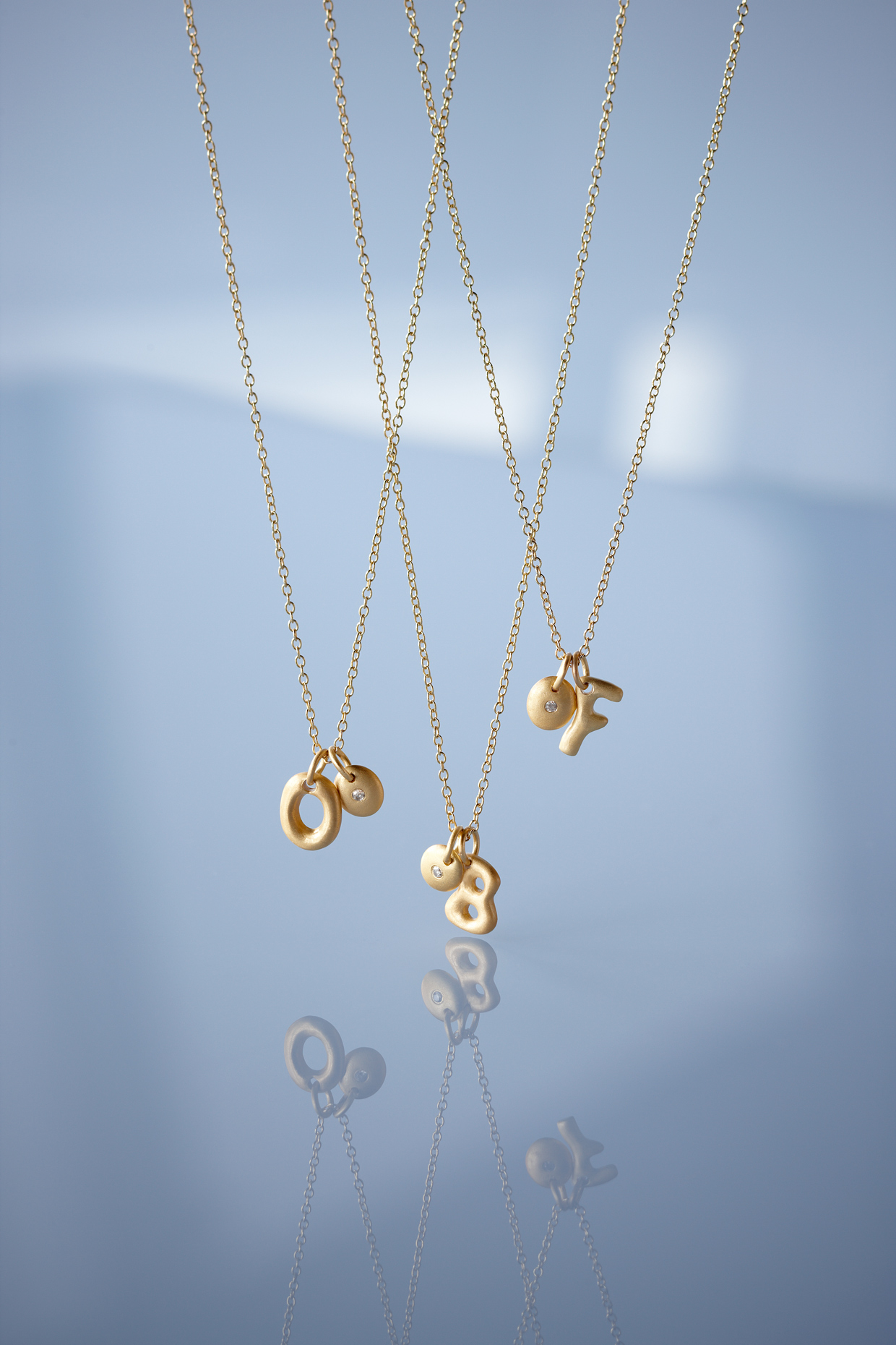 Product photography Jewelry Derek Israelsen Gold Letter Necklace
