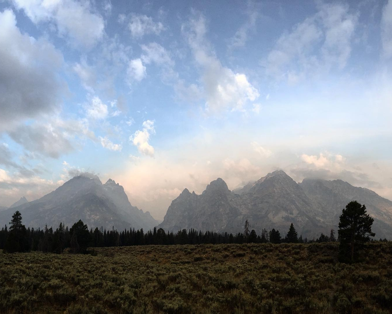 Spent_the_weekend_in__jacksonhole__wyoming_came_across_this_view_of_the__tetonrange_and__cascadecanyon._smoke_filled_the_skies_from_the_Berry_fire_at_the_north_end_of__gtnp.jpg