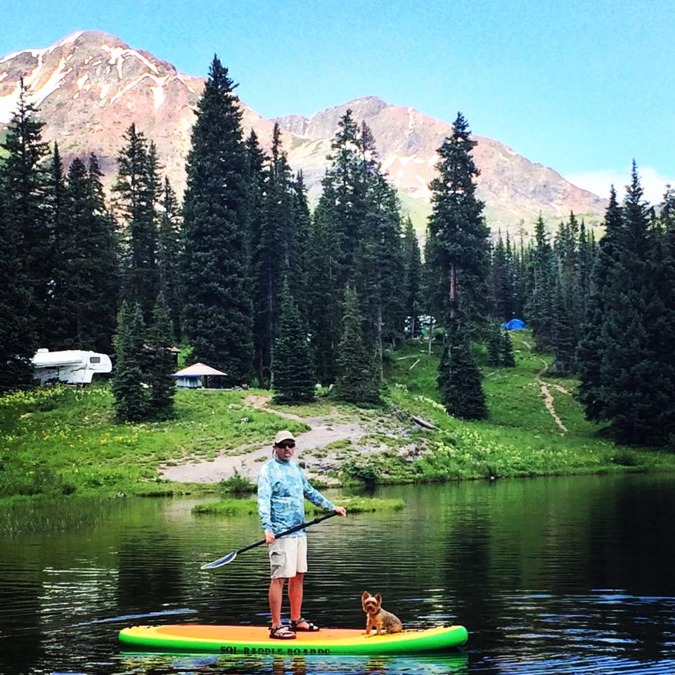 Pup's on a SUP by the campground.