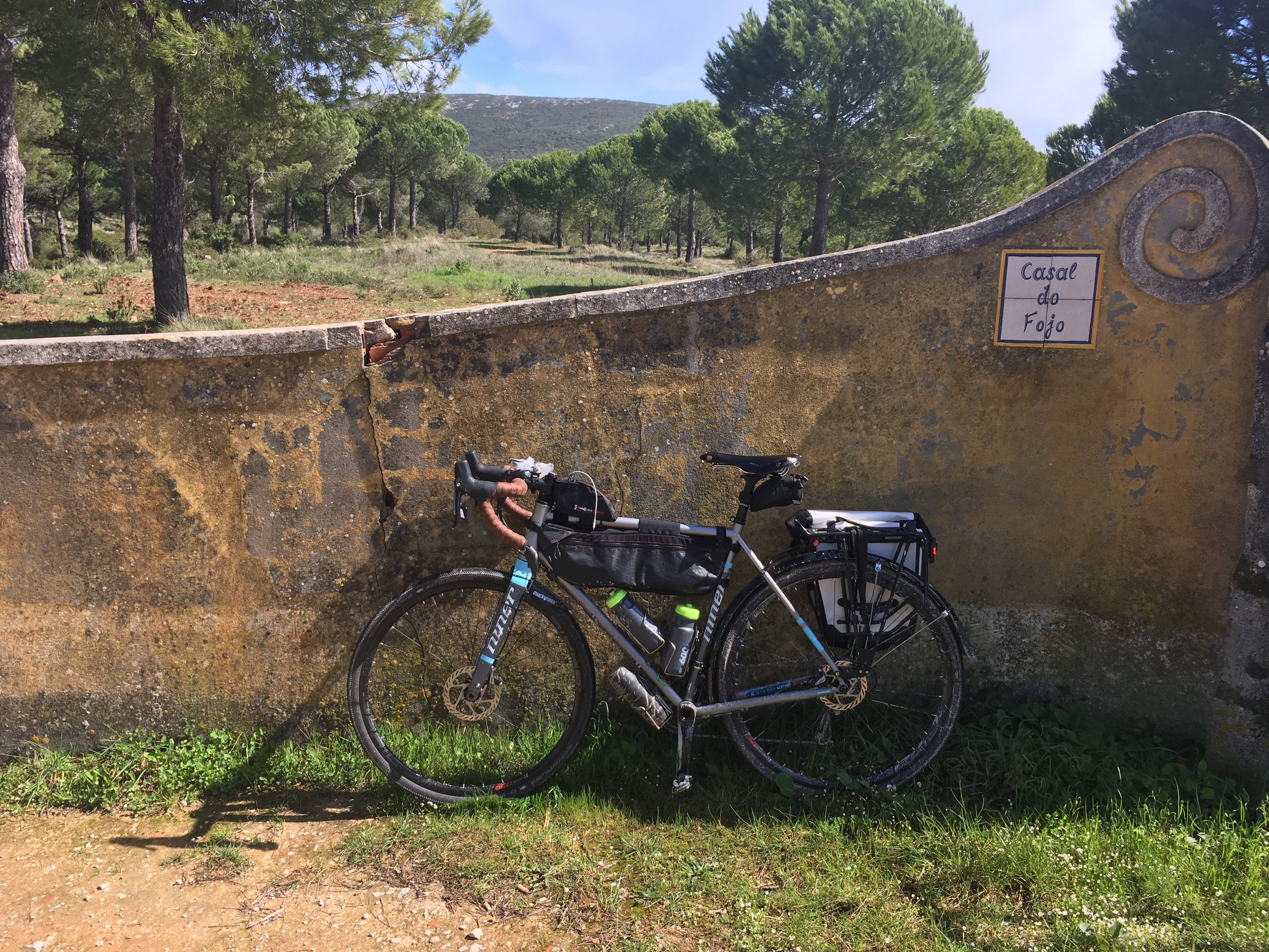wall and bike on gravel road.jpg