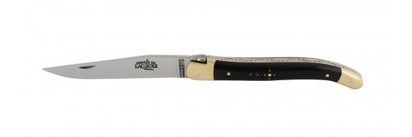 Laguiole   pocket knife with cow horn handle and brass bolsters. Note bee on locking mechanism.