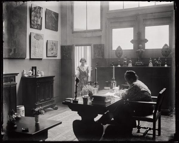 Stein writing in the studio where she held her salon, with her companion Alice B. Toklas.