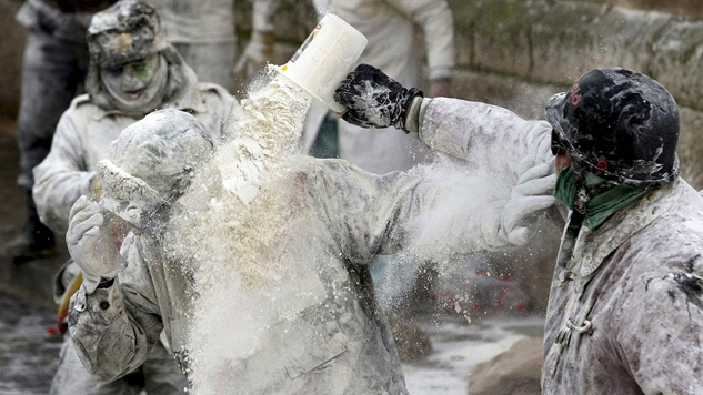 Portuguese dousing each other with flour. They also sometimes throw eggs, in which case you can bake a cake.