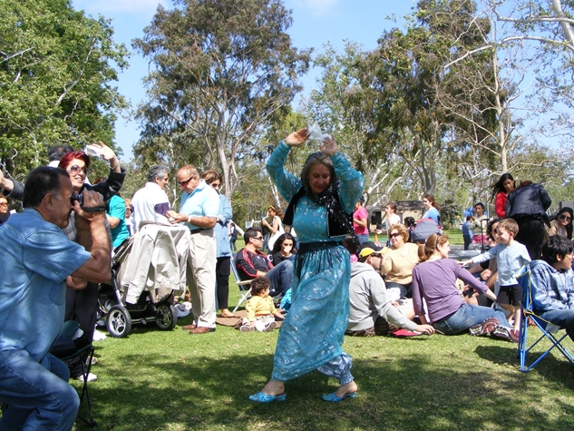 A lady dancing during  Sizdah Bedar  in Iran.