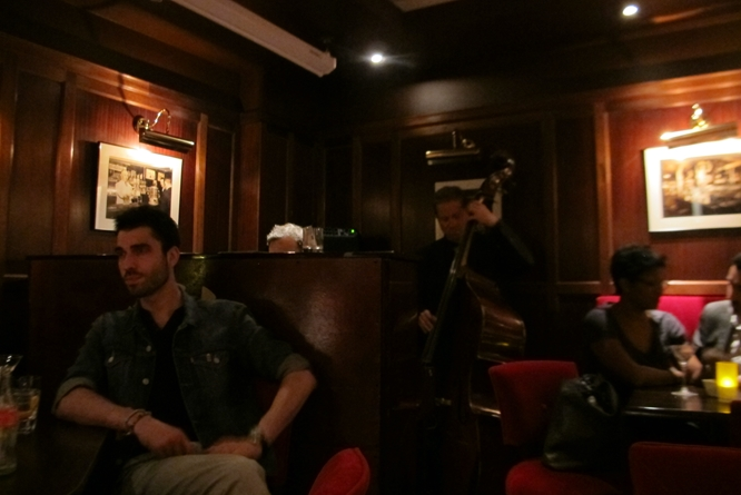 The piano lounge at Harry's New York Bar, one of Papa's favorite watering holes where George Gershwin composed  An American in Paris  at its piano.