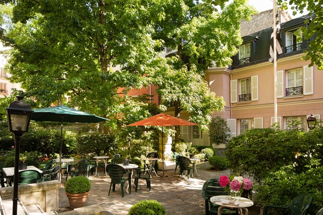 The courtyard in our  très charmant hotel , an oasis in the heart of the Latin Quarter.