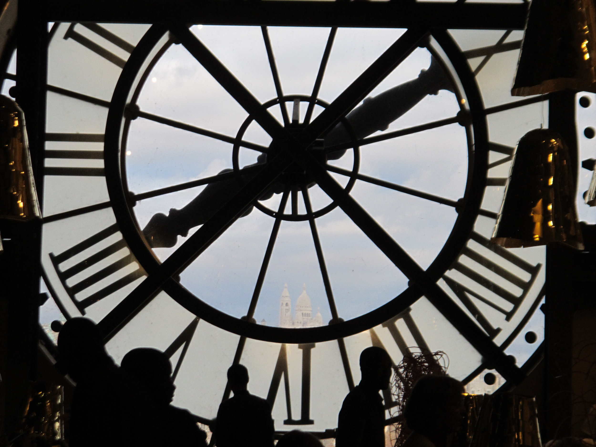 View of  SacréCoeur  in Montmartre from the clock face of the  Musée d'Orsay,  formerly the  Gare d'Orsay  train station. Photo: Elizabeth Kemble