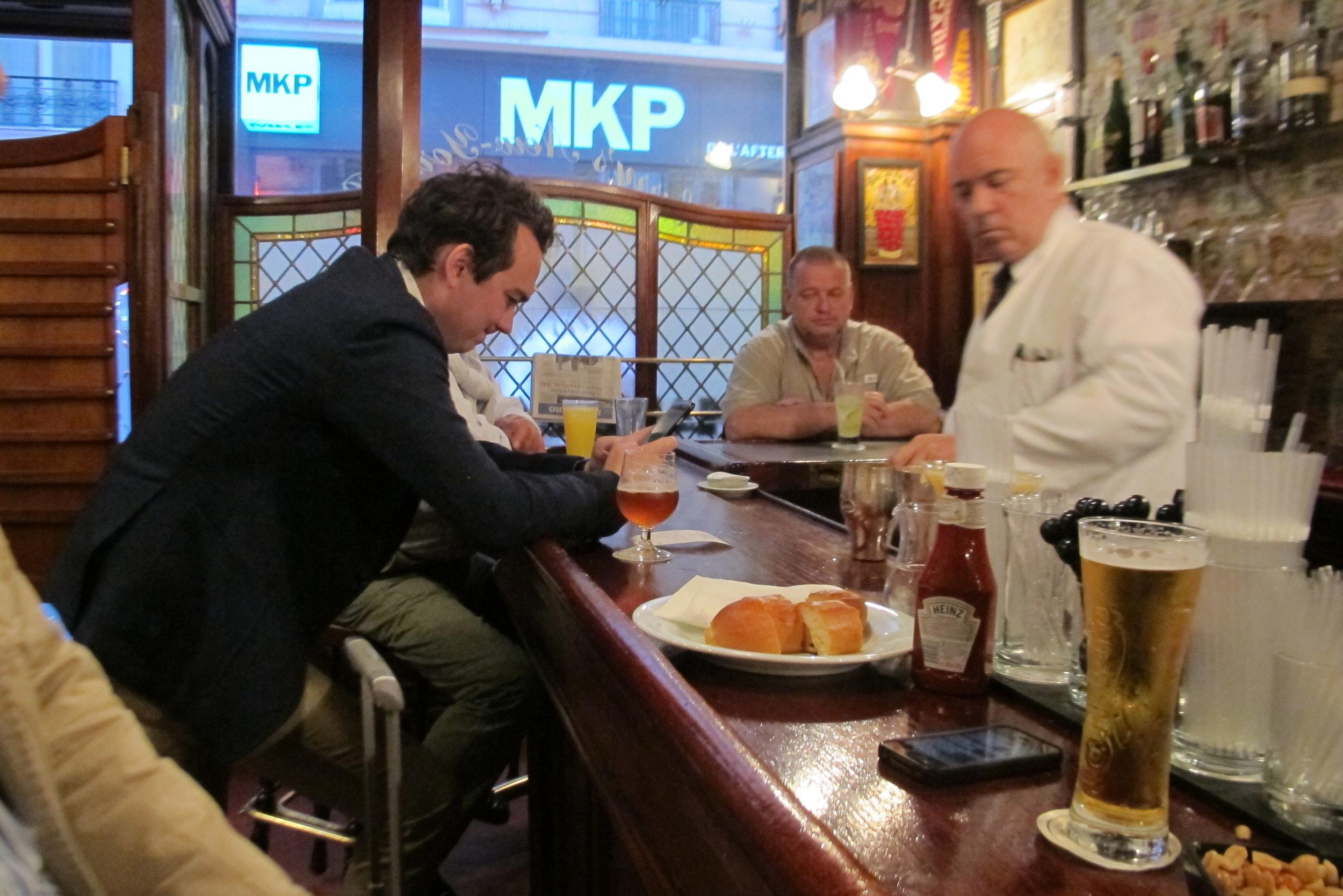 Guys being guys at Harry's New York Bar in Paris. Photo: Elizabeth Kemble.