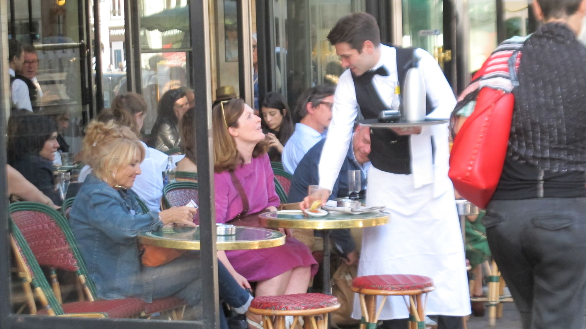 Guests at a café in the Saint Germain des Prés area of Paris.
