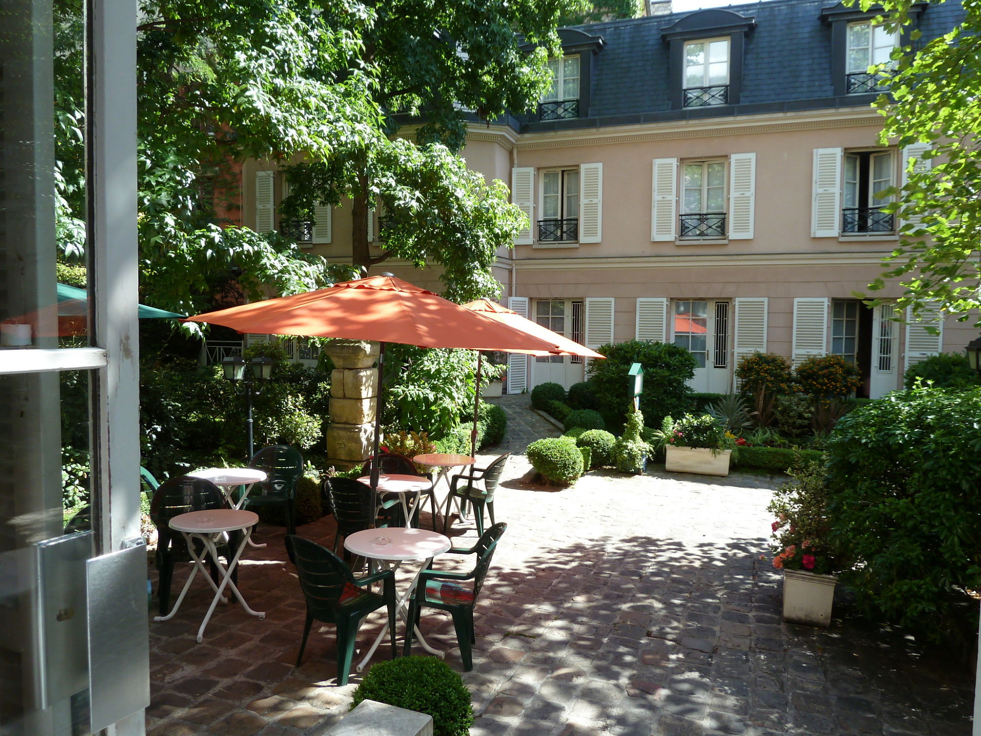 Shady garden of our hotel in Paris.