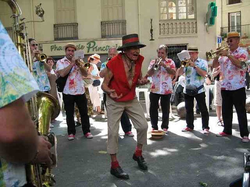 Dancing in the streets to a traditional  banda  during the Cherry Festival in Céret.