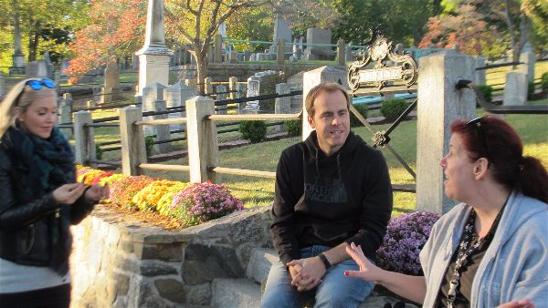 Guests from Chicago with docent in front of Washington Irving's family plot in  Sleepy Hollow Cemetery .   Photo Travellati Tours.