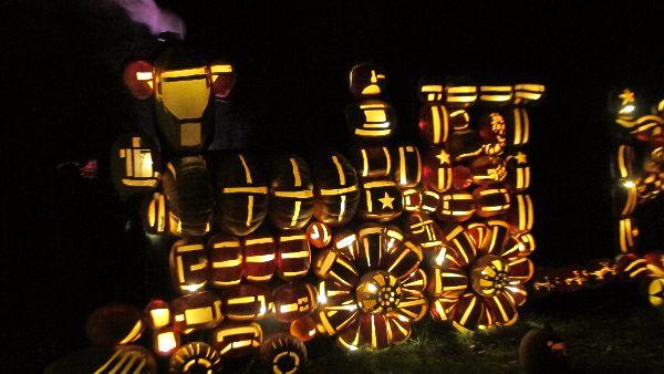 The Circus Train engine puffing purple steam at the  Great Jack O'Lantern Blaze  at Van Cortlandt Manor.   Photo Travellati Tours.