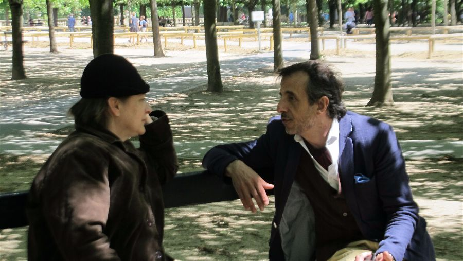 Gertrude Stein (Constance Bradburn) and Ernest Hemingway (David Coburn) performing for our guests in the Luxembourg Gardens in Paris.   Photo Travellati Tours.