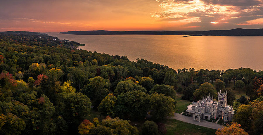 Aerial sunset view of Lyndhurst Mansion and the Hudson River in Tarrytown, NY.