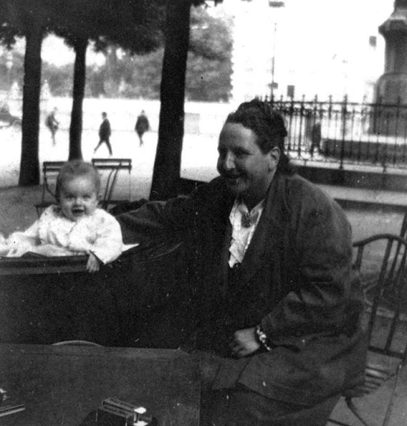 "Gertrude Stein in the Luxembourg Gardens in Paris with Ernest Hemingway's first son Jack or ""Bumby."""