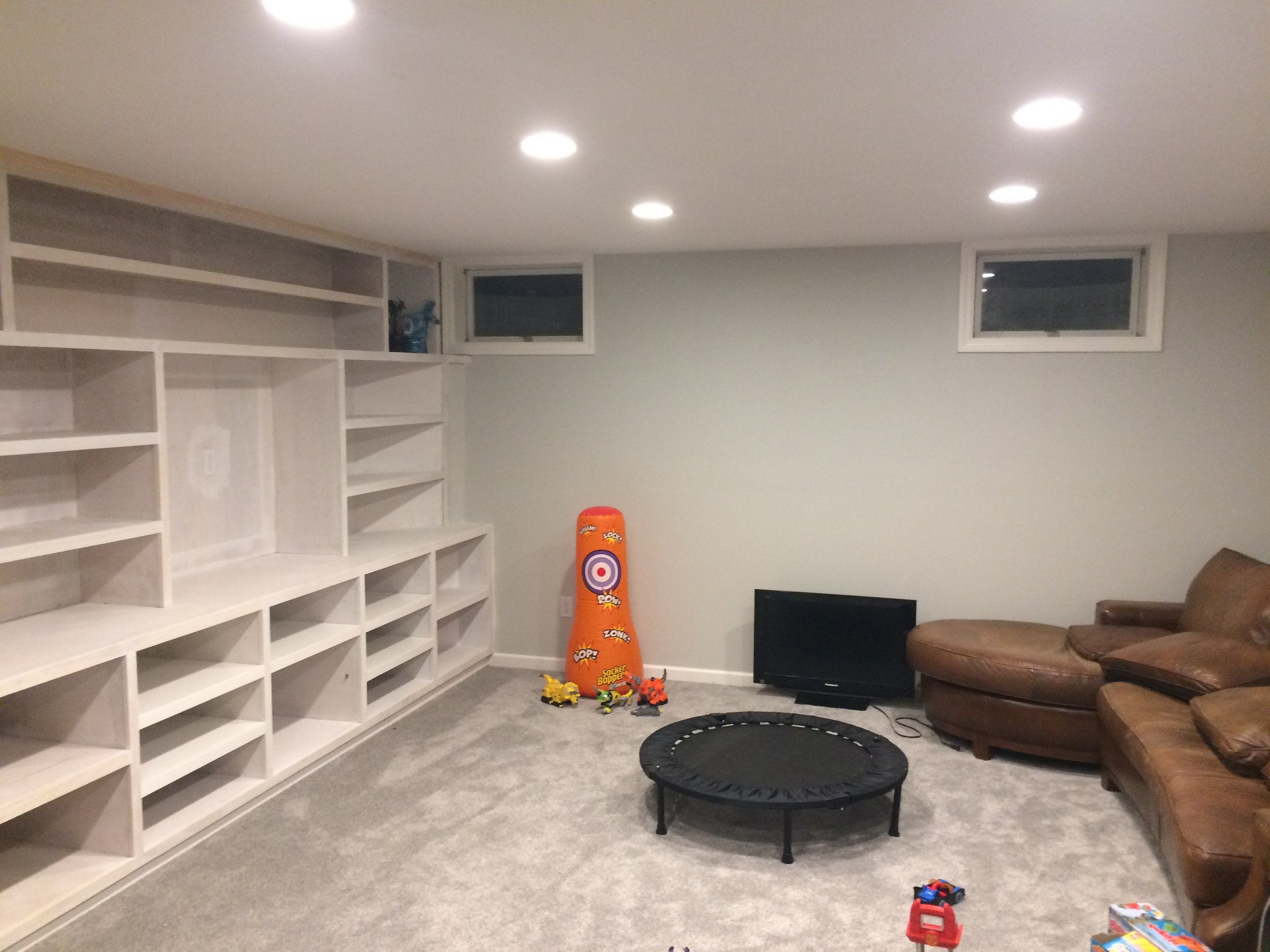 Custom basement renovation plus custom built-ins (waiting for paint)