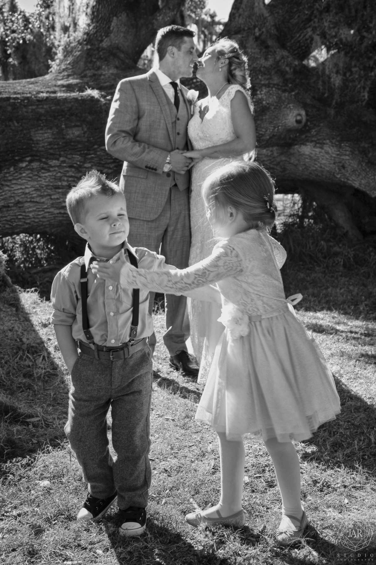 16-kids-wedding-cute-fun-kiss-hipster-suspenders-jarstudio.JPG