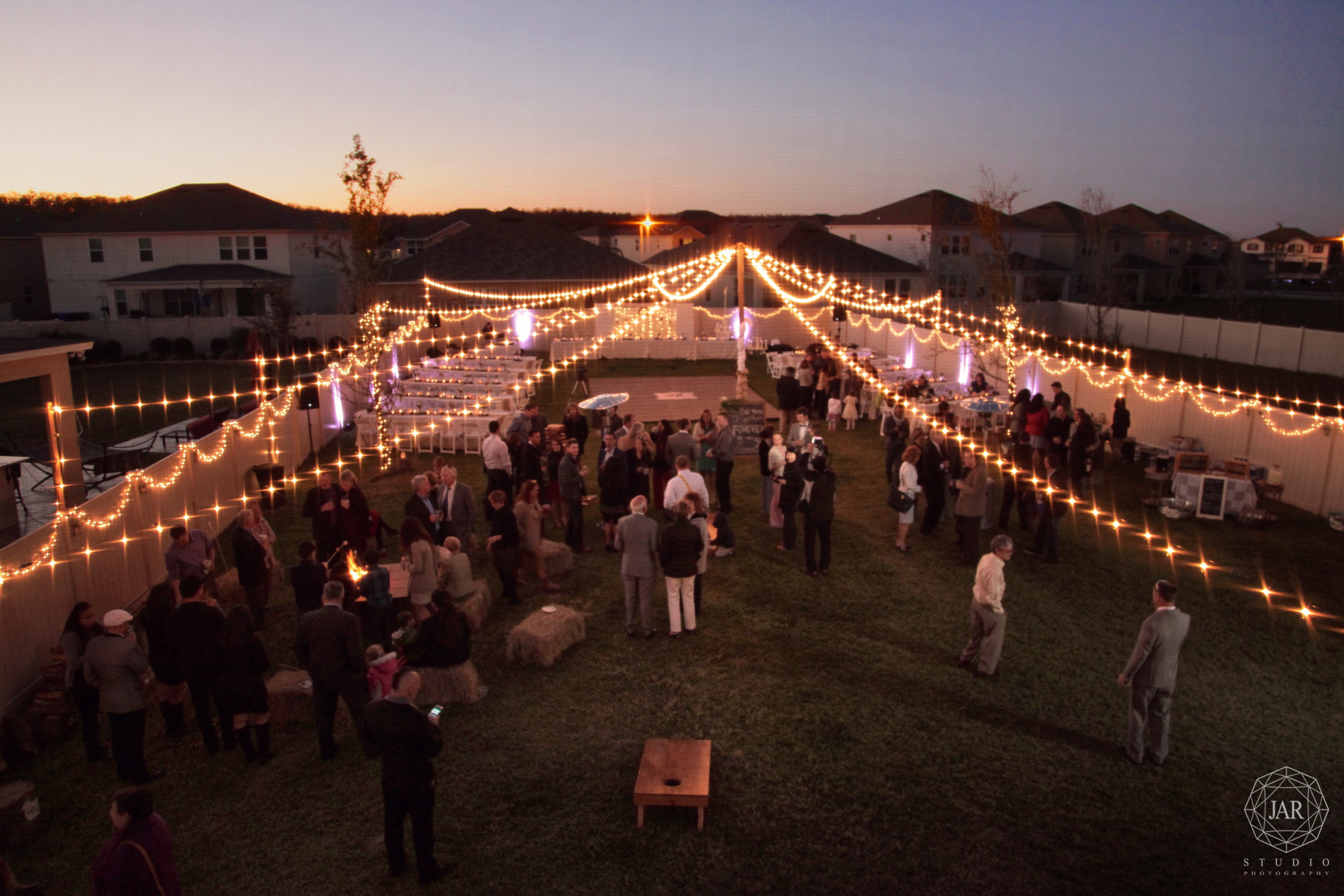 41-backyard-wedding-ideas-string-lights-jarstudio.JPG