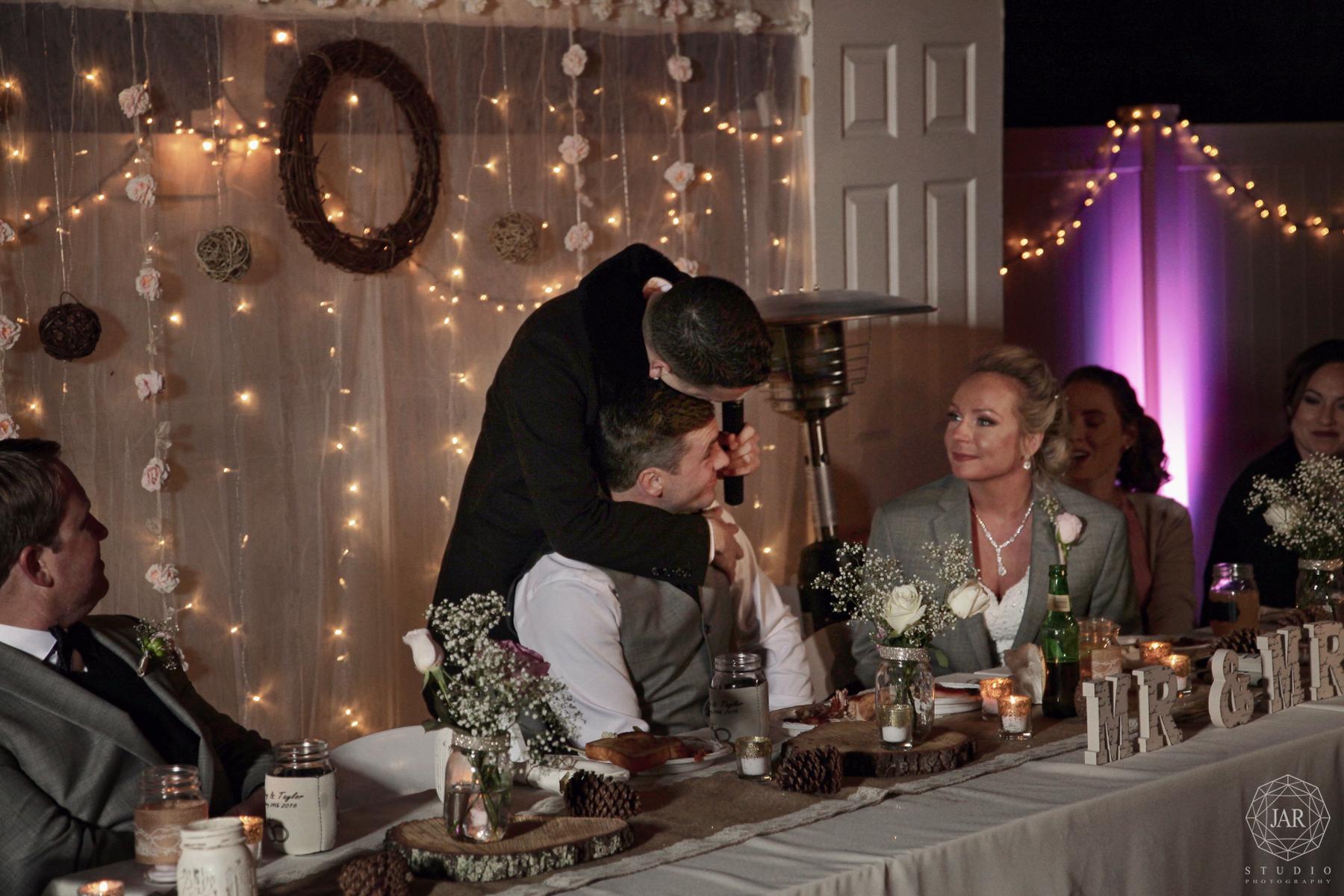 45-background-toast-lights-flowers-wedding-jarstudio.JPG