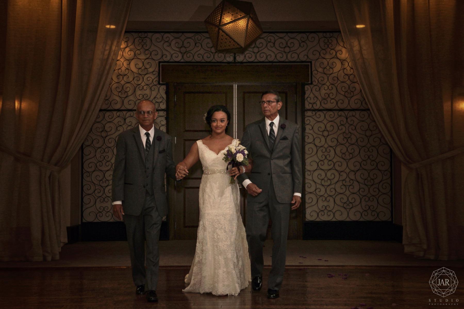 14-bride-ceremony-walking-alfond-inn-jarstudio.JPG