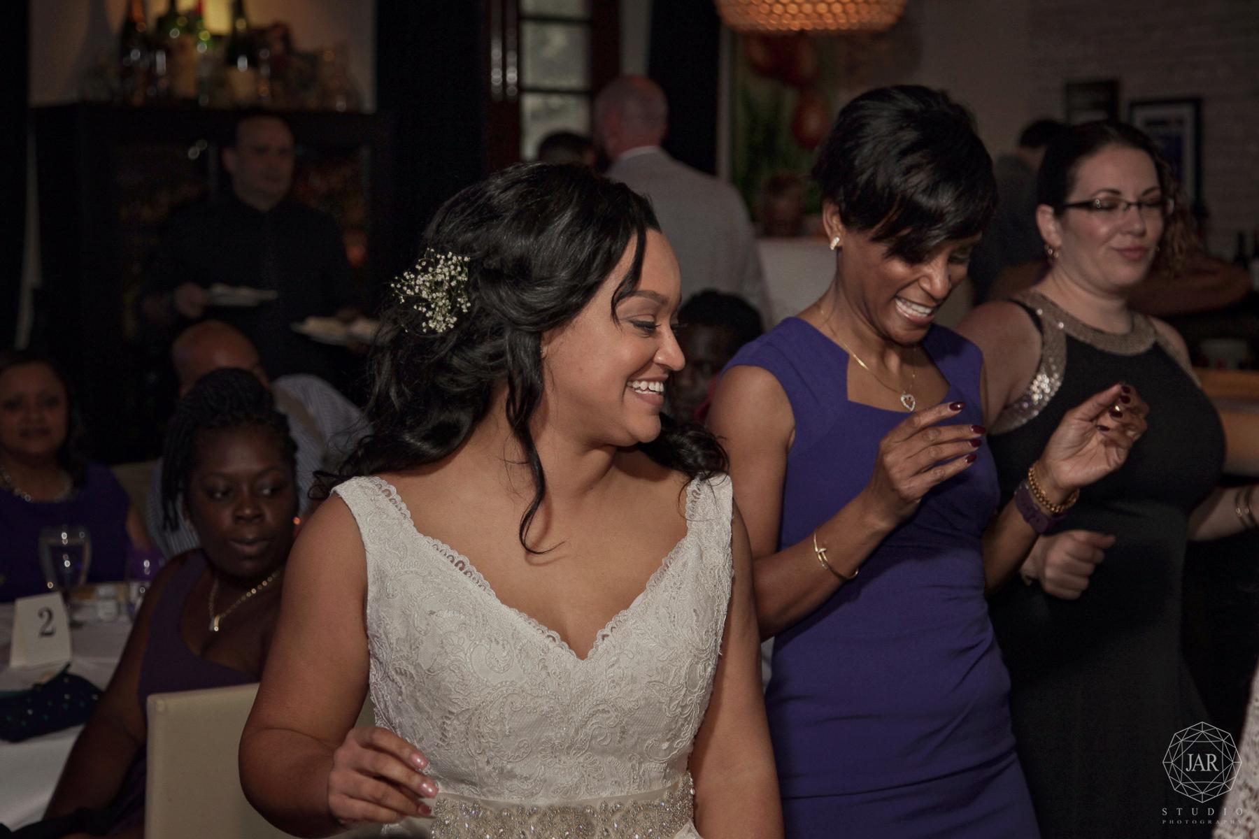 29-bride-mother-dancing-fun-jarstudio-photography.JPG