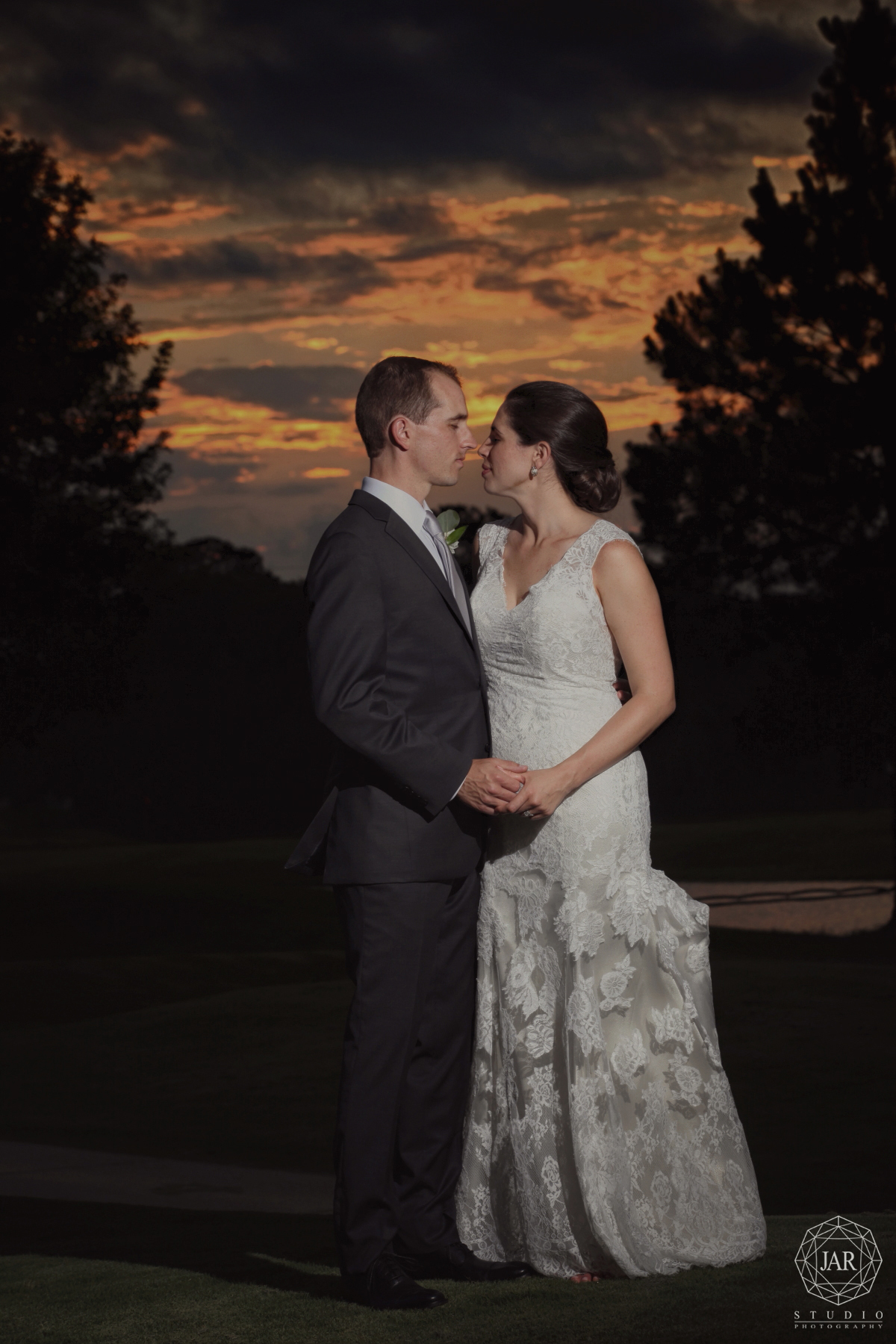 46-beautiful-bride-and-groom-portrait-gorgeous-sunset-colors-orlando-sky-jarstudio-photography.JPG