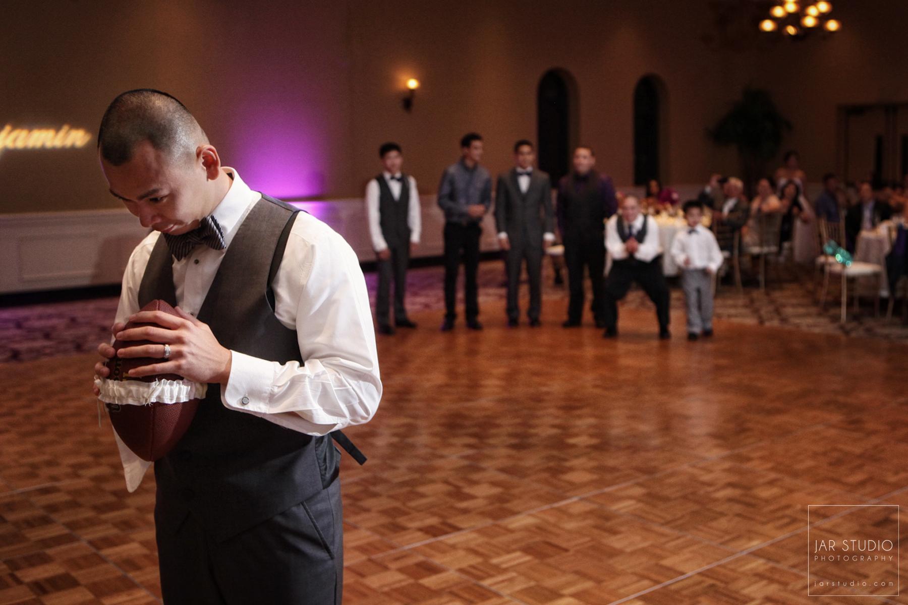27-original-idea-football-garter-toss-orlando-wedding-photography.JPG