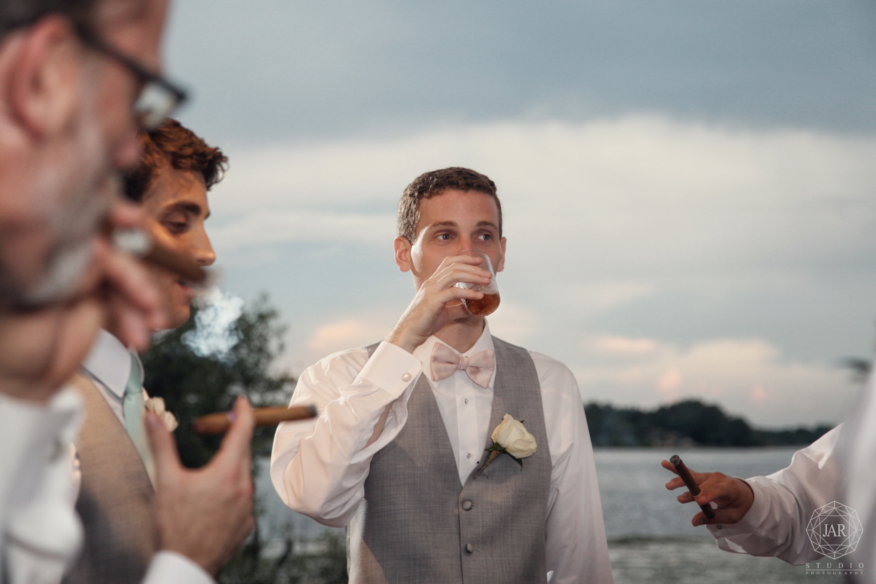 36-groomsmen-fun-shots-cigars-rollins-winter-park-wedding-photographer.JPG