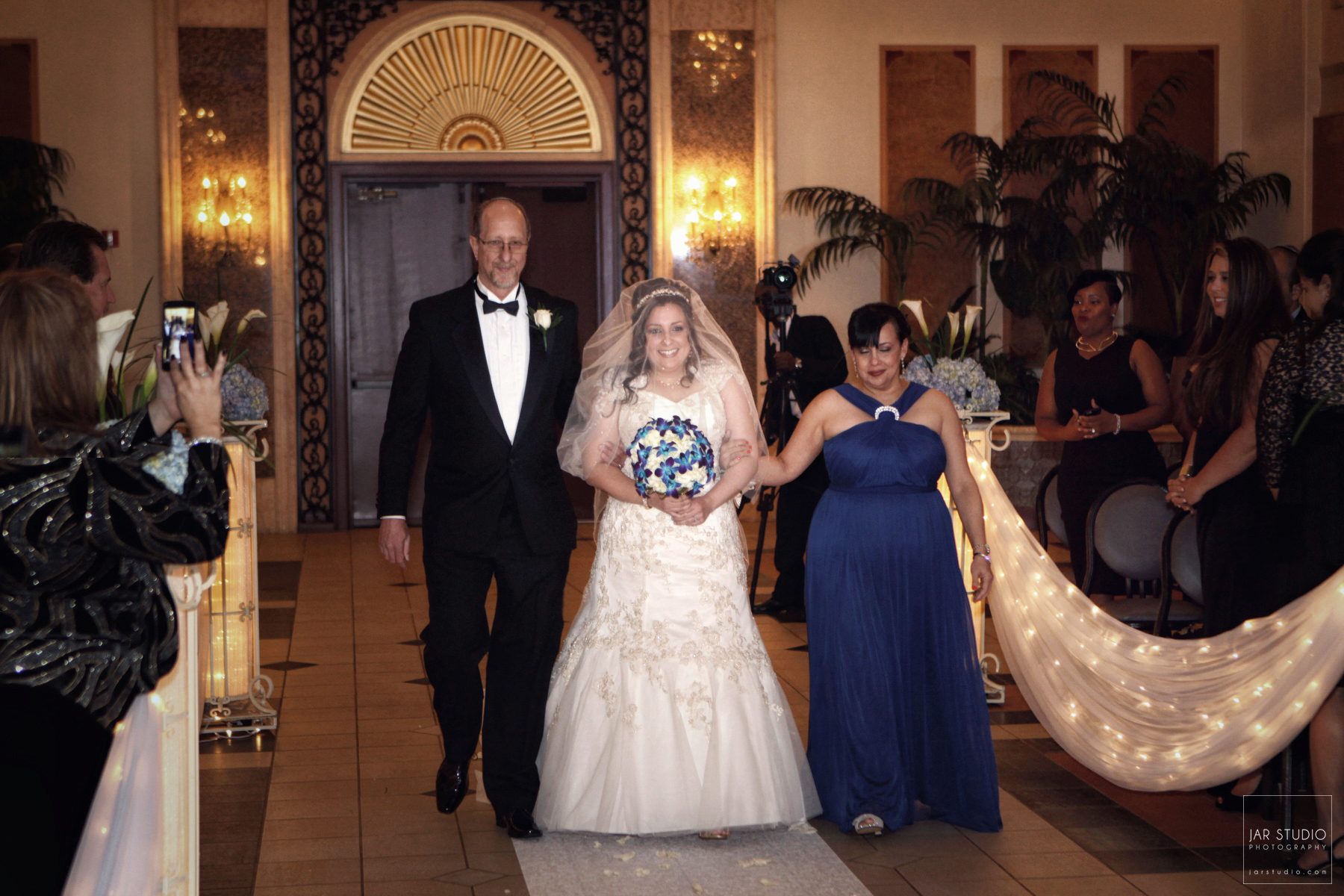 13-bride-walking-down-the-aisle-orlando-highend-wedding-photographer.JPG