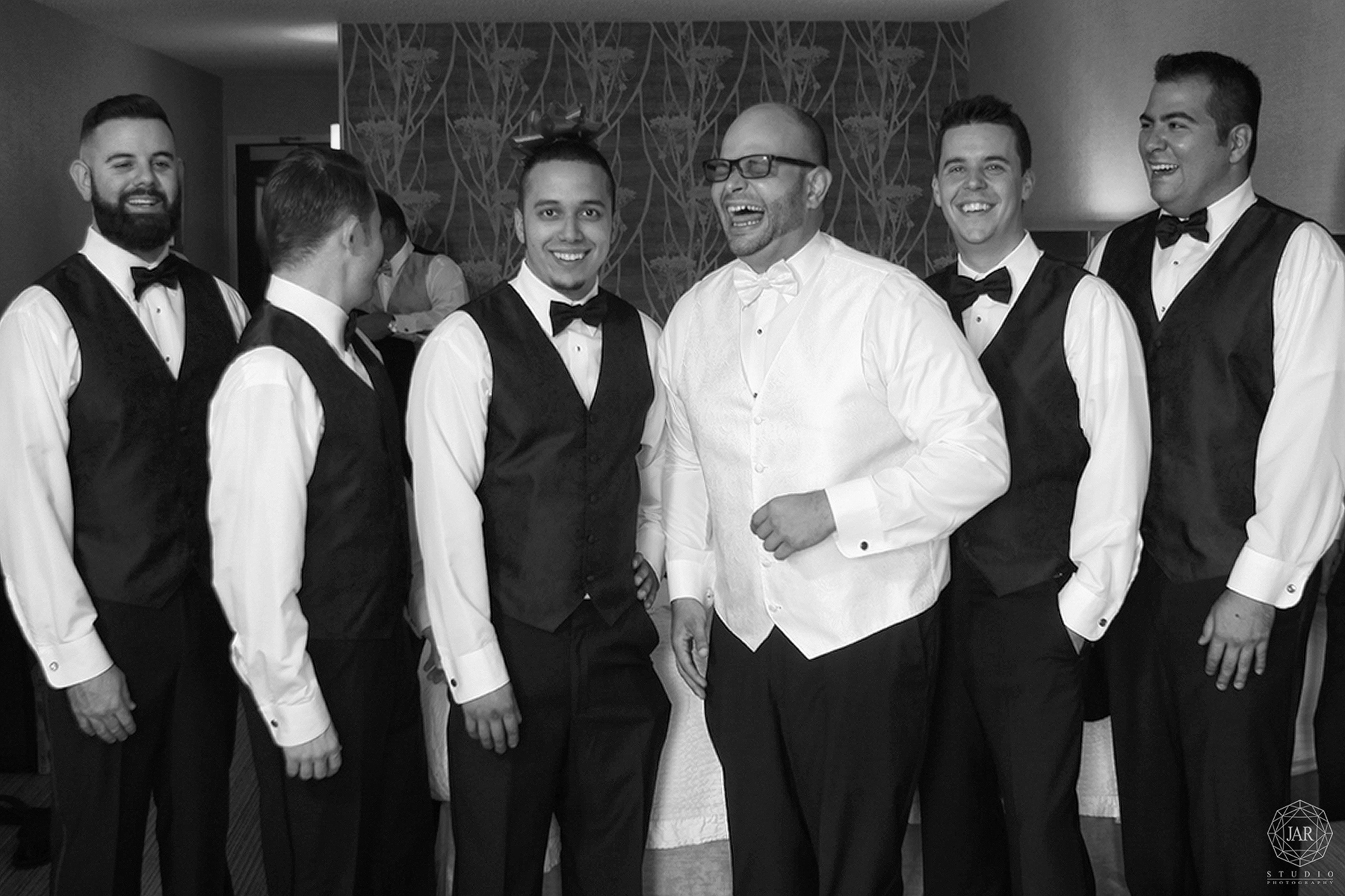 03-groom-getting-ready-fun-with-groomsmen-photographer-orlando.JPG