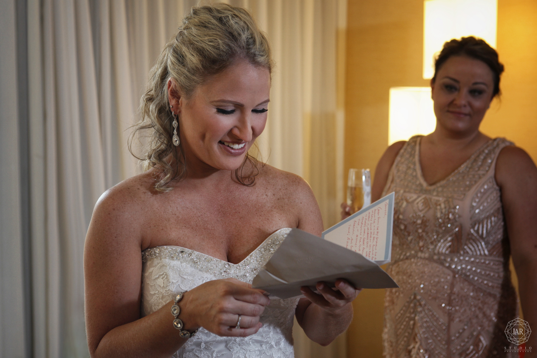 05-bride-reading-grooms-card-orlando-wedding-photographer.JPG