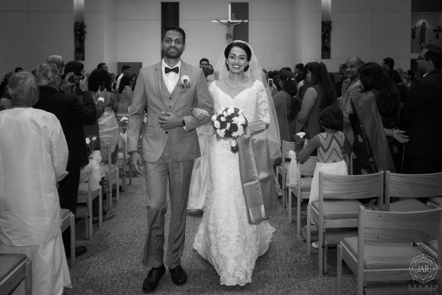 21-bride-groom-walking-beautiful-church-florida-wedding-photographer.jpg