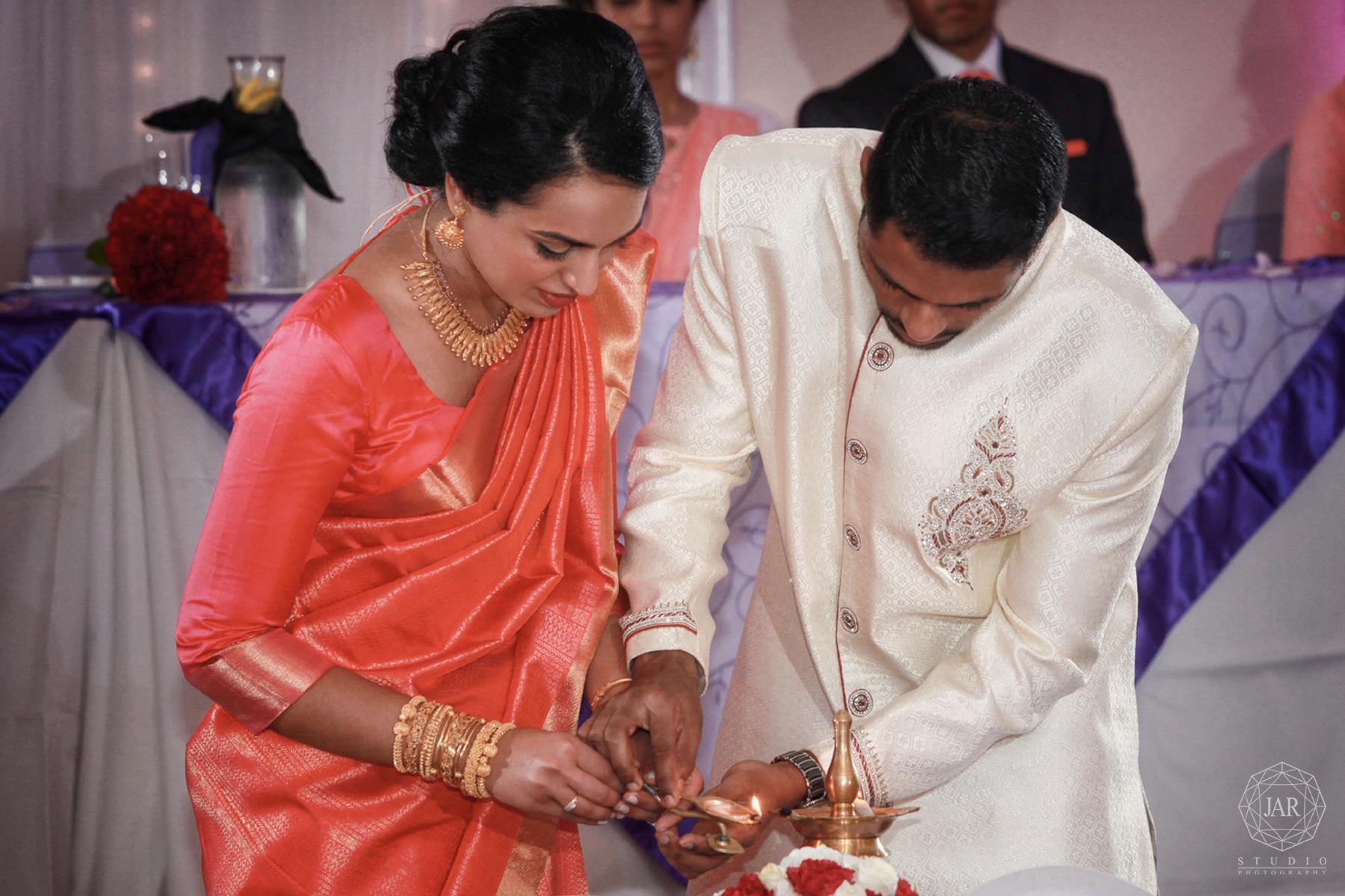 34-lamp-reception-tradition-indian-wedding-florida-photographer.jpg
