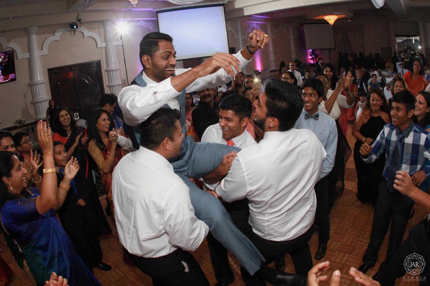 39-wedding-reception-fun-groom-photographer.jpg
