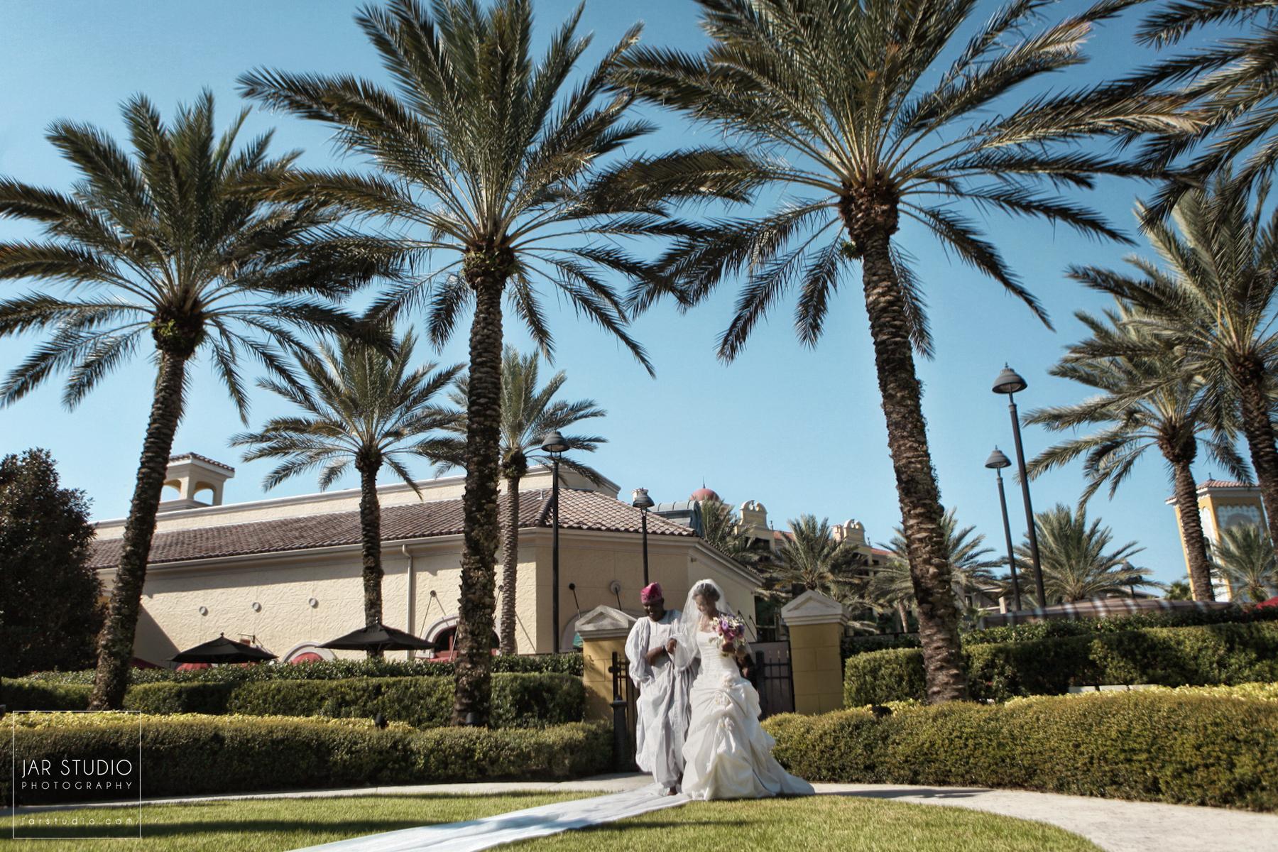 11-bride-walking-hilton-tuscany-orlando-destination-wedding-jarstudio-photography.JPG