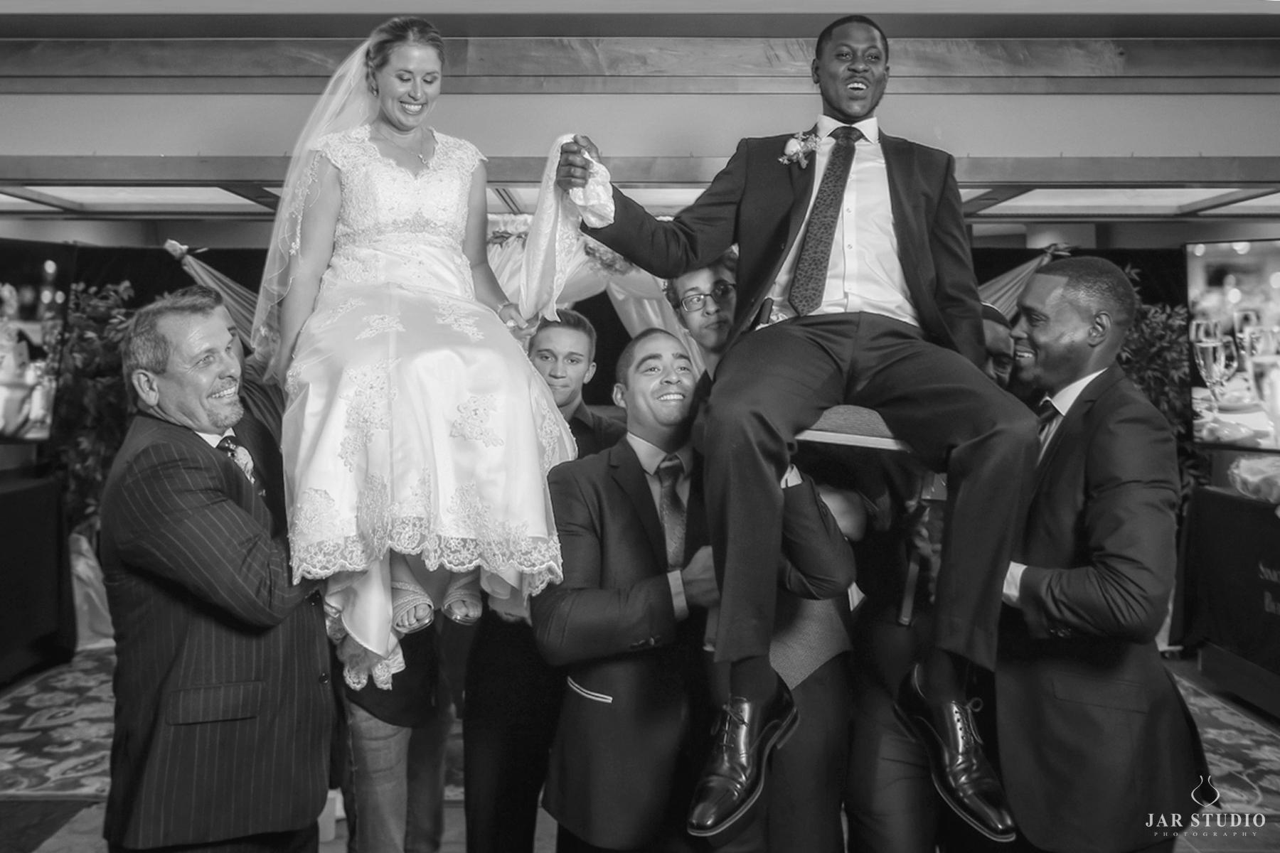 19-groom-bride-hora-jewish-reception-jarstudio-photography.jpg