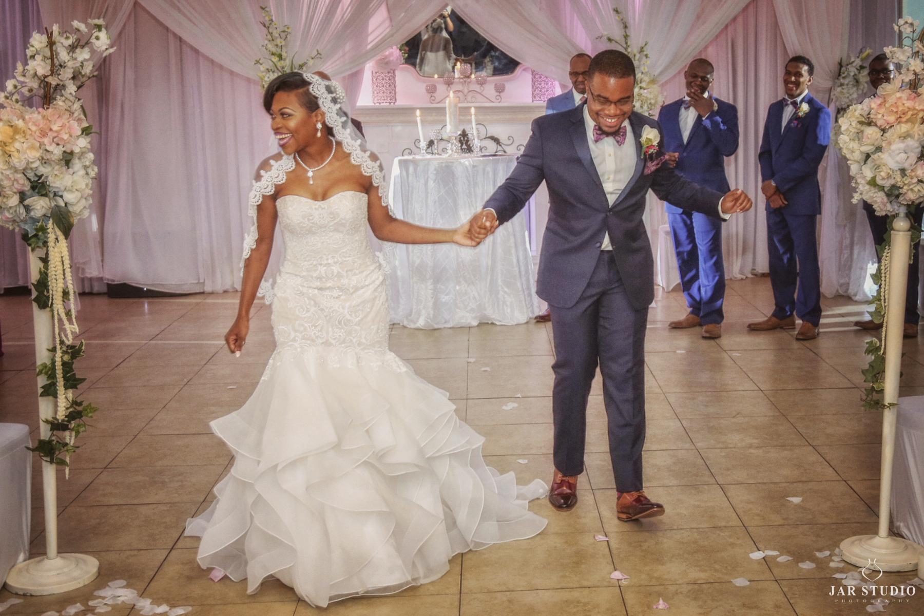 27-ceremony-happy-exit-jarstudio-wedding-photographer.JPG