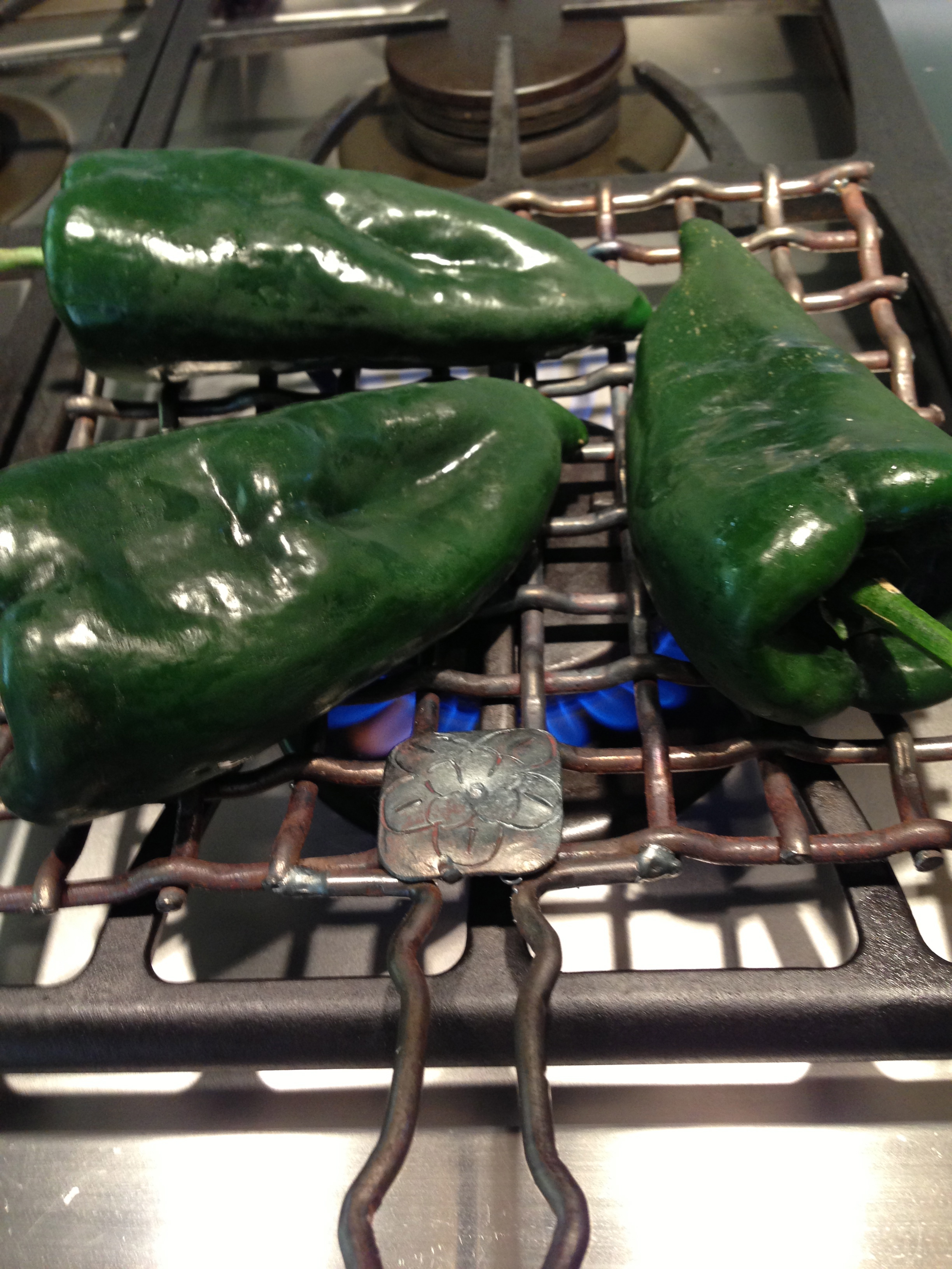 Chiles roasting on my uber-cool iron roasting basket from Valerie Rice.
