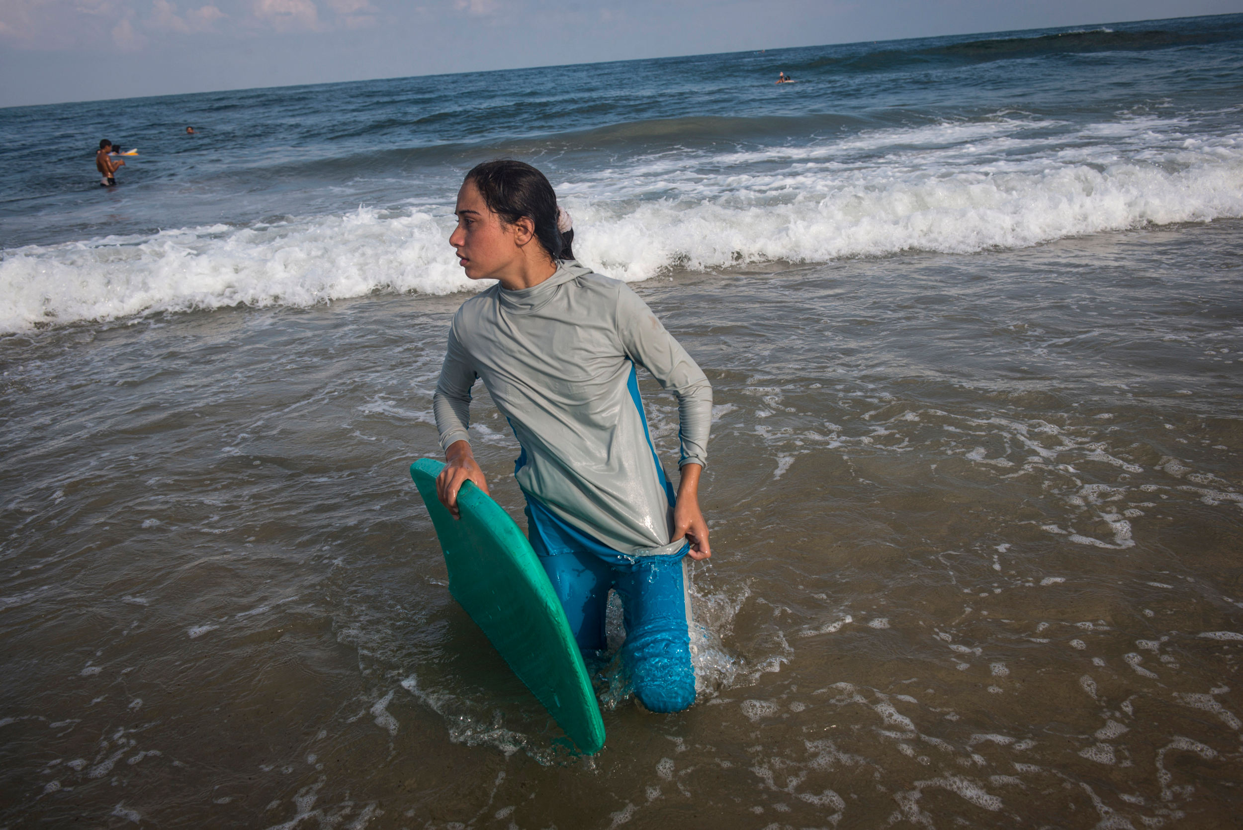 For many Gazans the sea is the only place they can be without being reminded of their isolation. Female Surfer, Sabah Abu Ghanem ,14 and her sister surf early in the morning outside of Gaza city. The sisters place first in many competitions inside the strip, but have never left the Gaza Strip to compete.