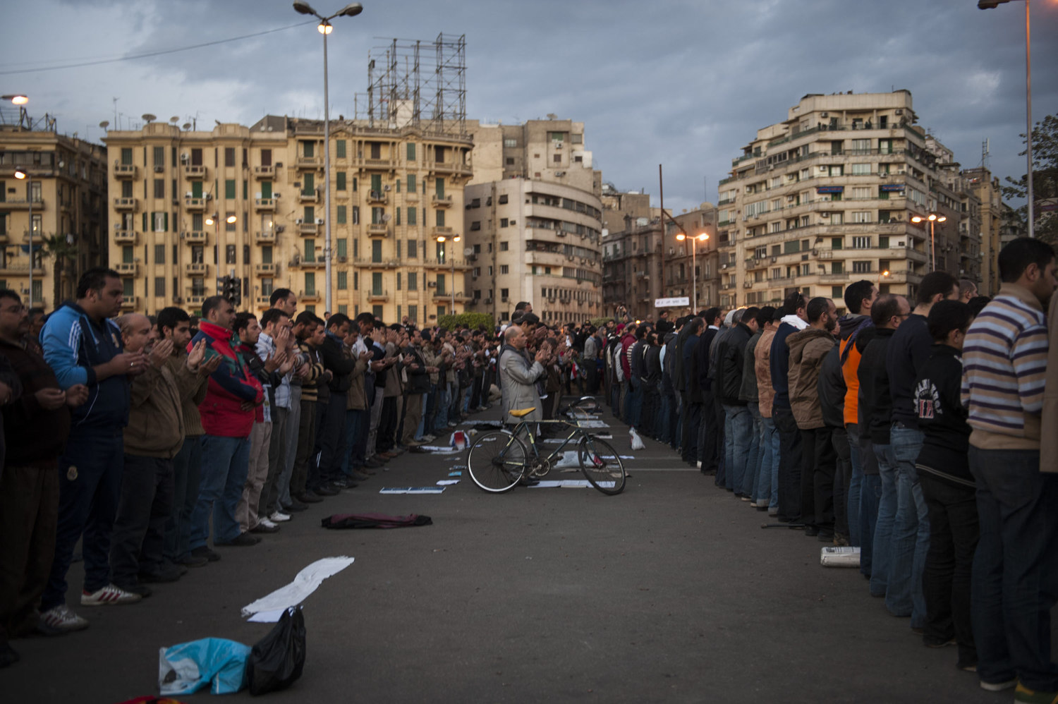 Demonstrators pray during the evening as a peaceful protest against the Mubarak regime in Tahrir Square.