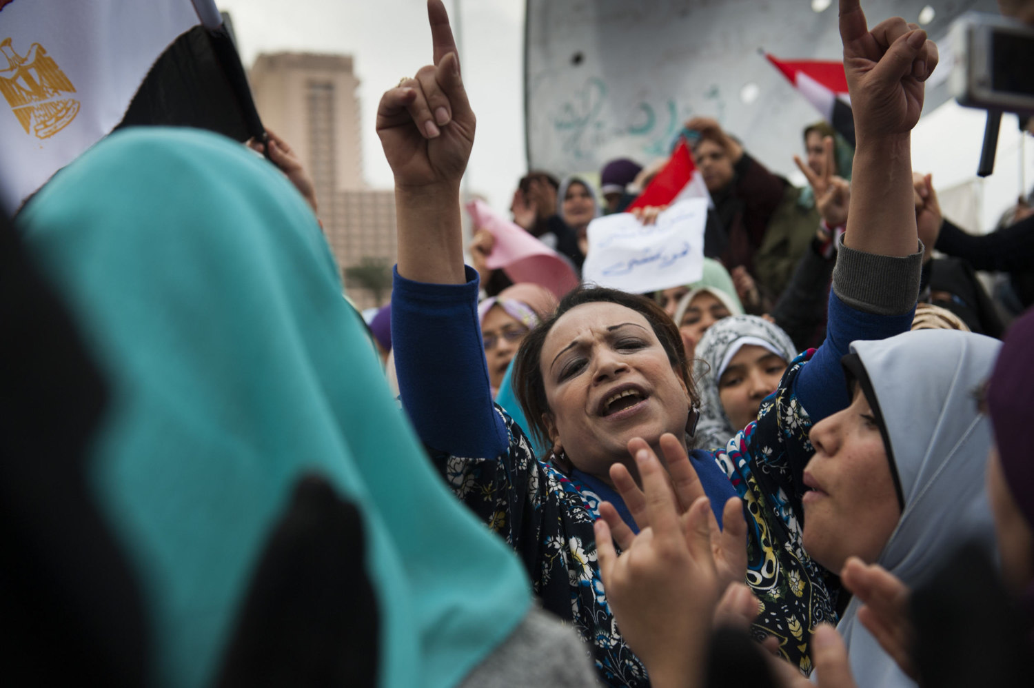 A woman leads the singing during a demonstration in Tahrir Square on February 6, 2011.