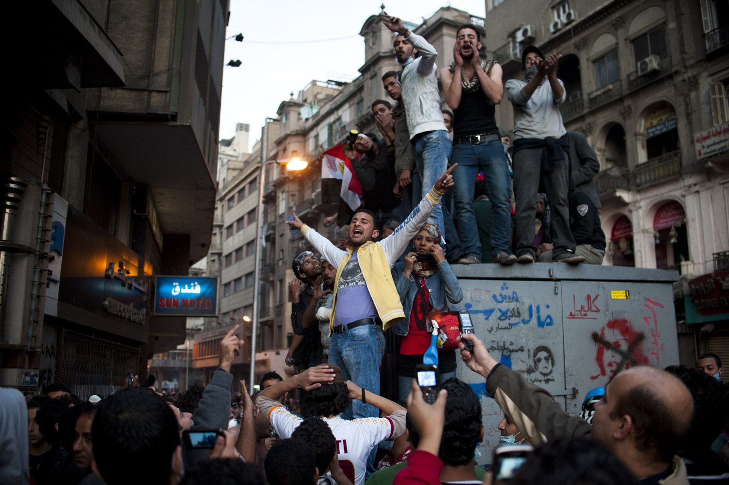 A group of youth's stand and sing revolutionary songs to onlookers on November 22nd 2011.