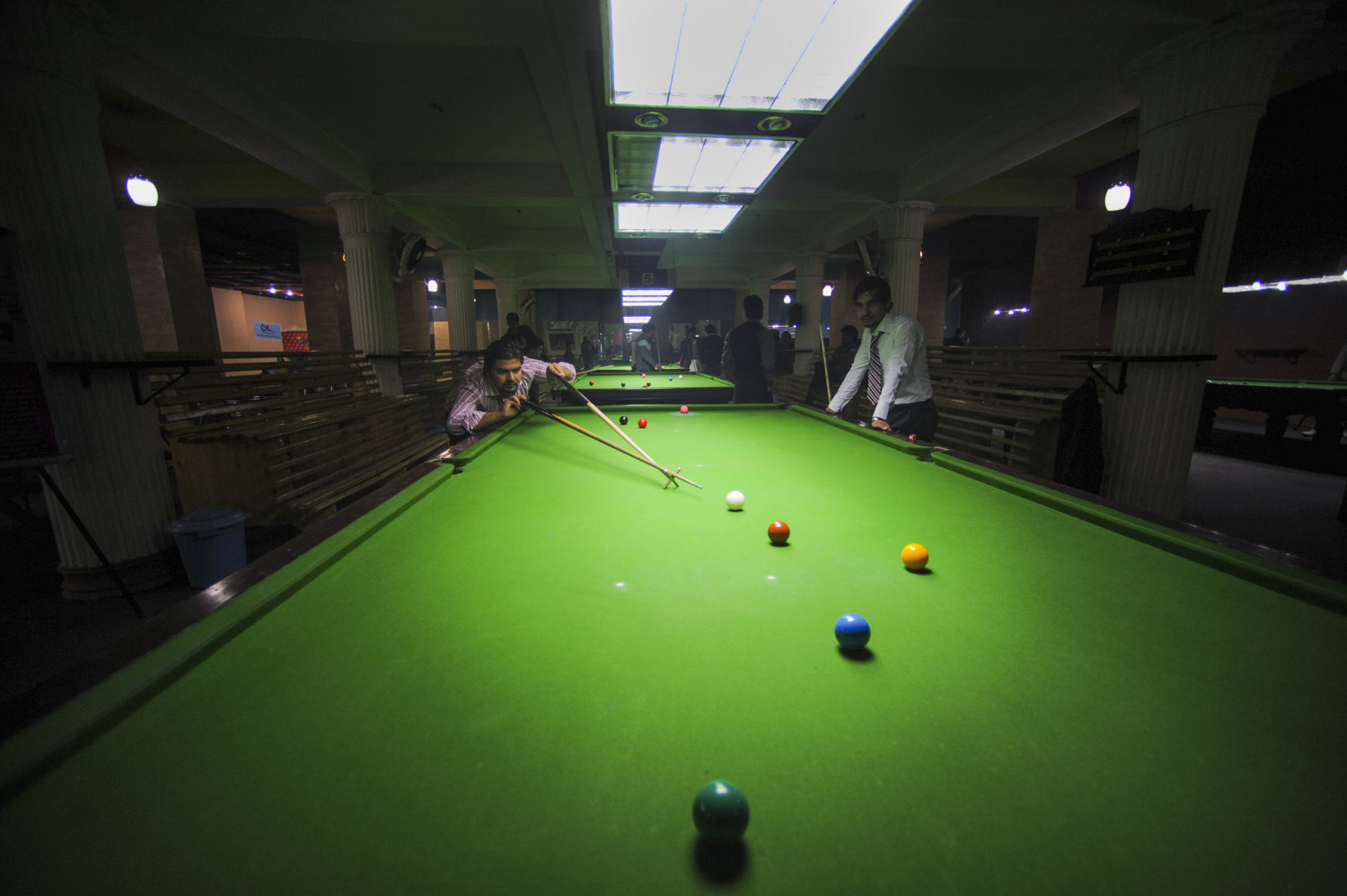 Yama Ismail plays Snooker at Target Game Zone in Haki Yqoob Square, Kabul Afghanistan. Snooker is a popular game for upper-class afghanis. The Snooker halls come alive after work hours are over also Tournaments are very popular.