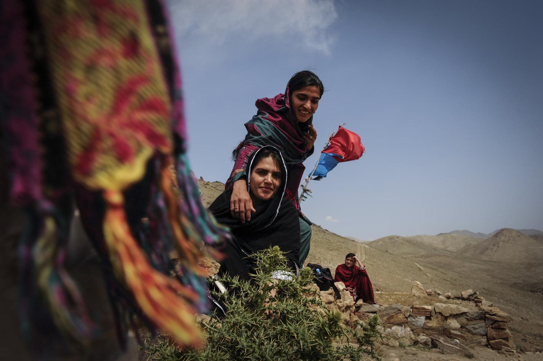 Girls visit a Shrine near Karga Lake outside of Kabul, Afghanistan.