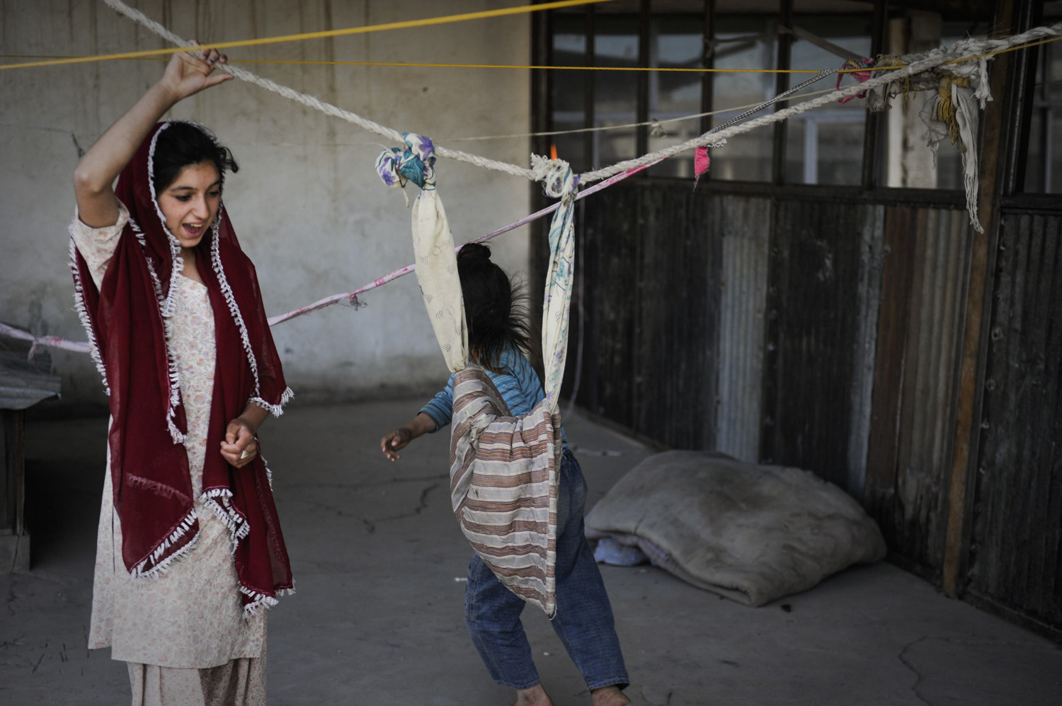 A sikh girl plays with her little brother in Kabul, Afghanistan. Many Sikh's including boys don't attend school in Afghanistan as they are marginalized in the community. Homeschooling is not an option as many parents have not attended schooling either.