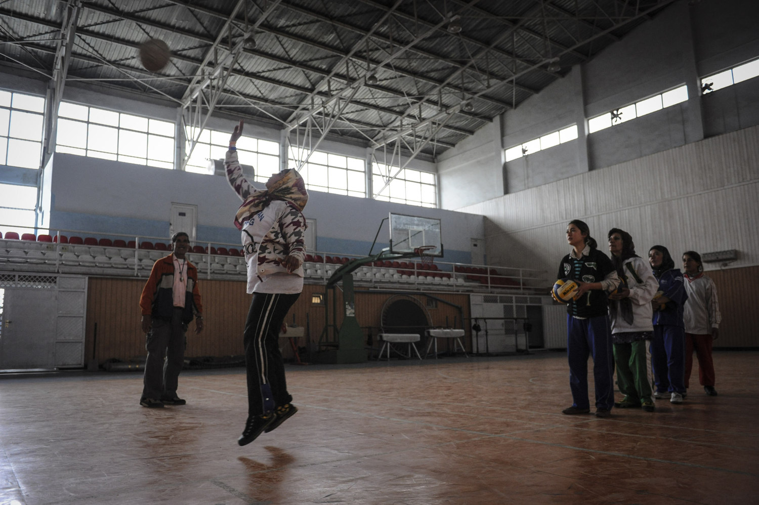 Girls play volleyball in the Olympic Stadium's Women's Gym in Kabul Afghanistan. The girls come three times a week to play volleyball against each other as there is no other team in the country. Coach Abdul Hamid Sufi says that the girls are more interested in volleyball than the boys, and volunteer's his time as the Afghan government does not support the women's team.